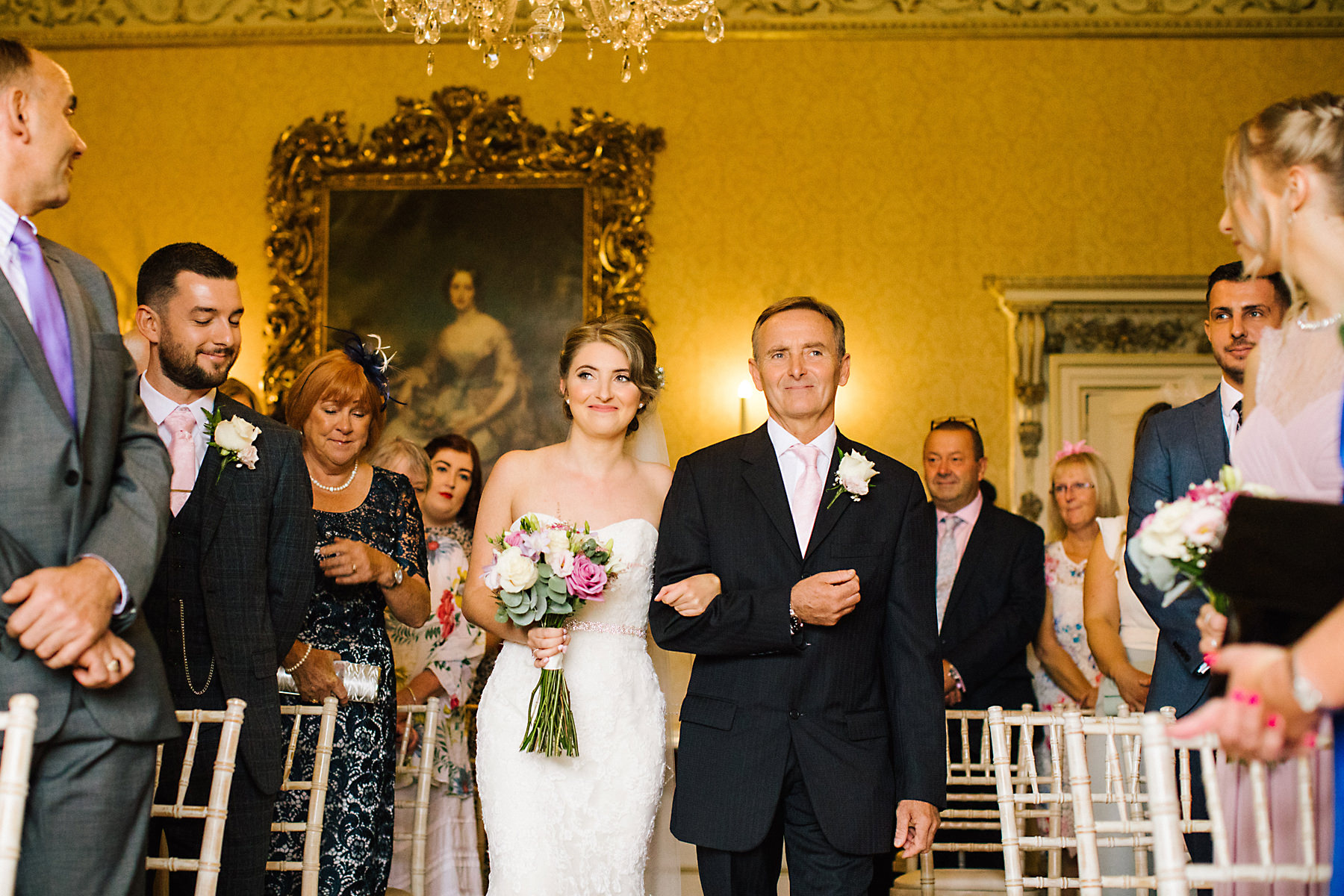 bride and dad walking down aisle at arley hall