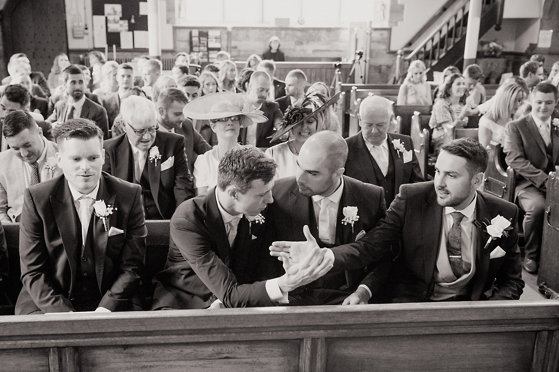 groom sat on church pew