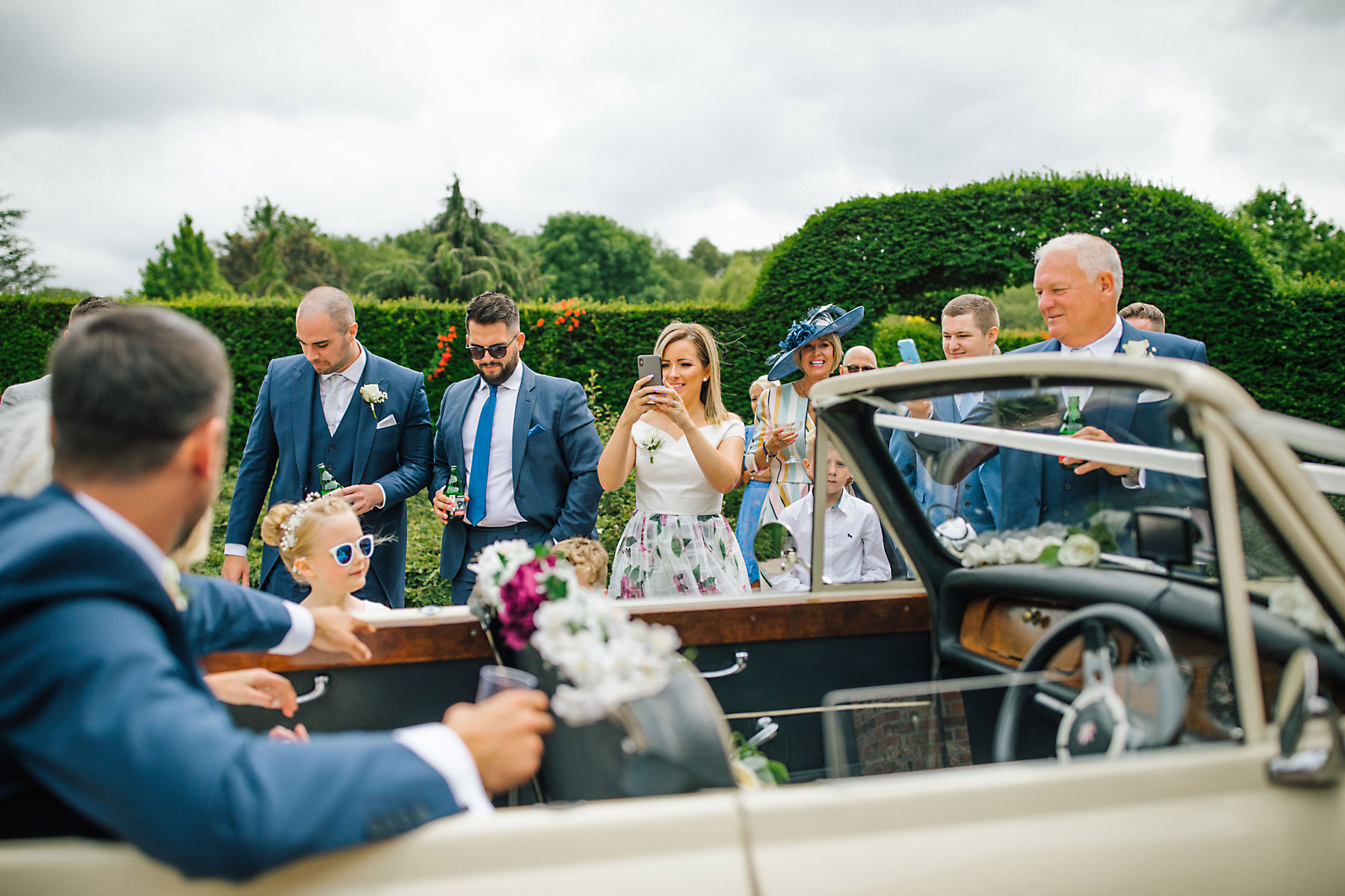 bride and groom arriving at holford estate