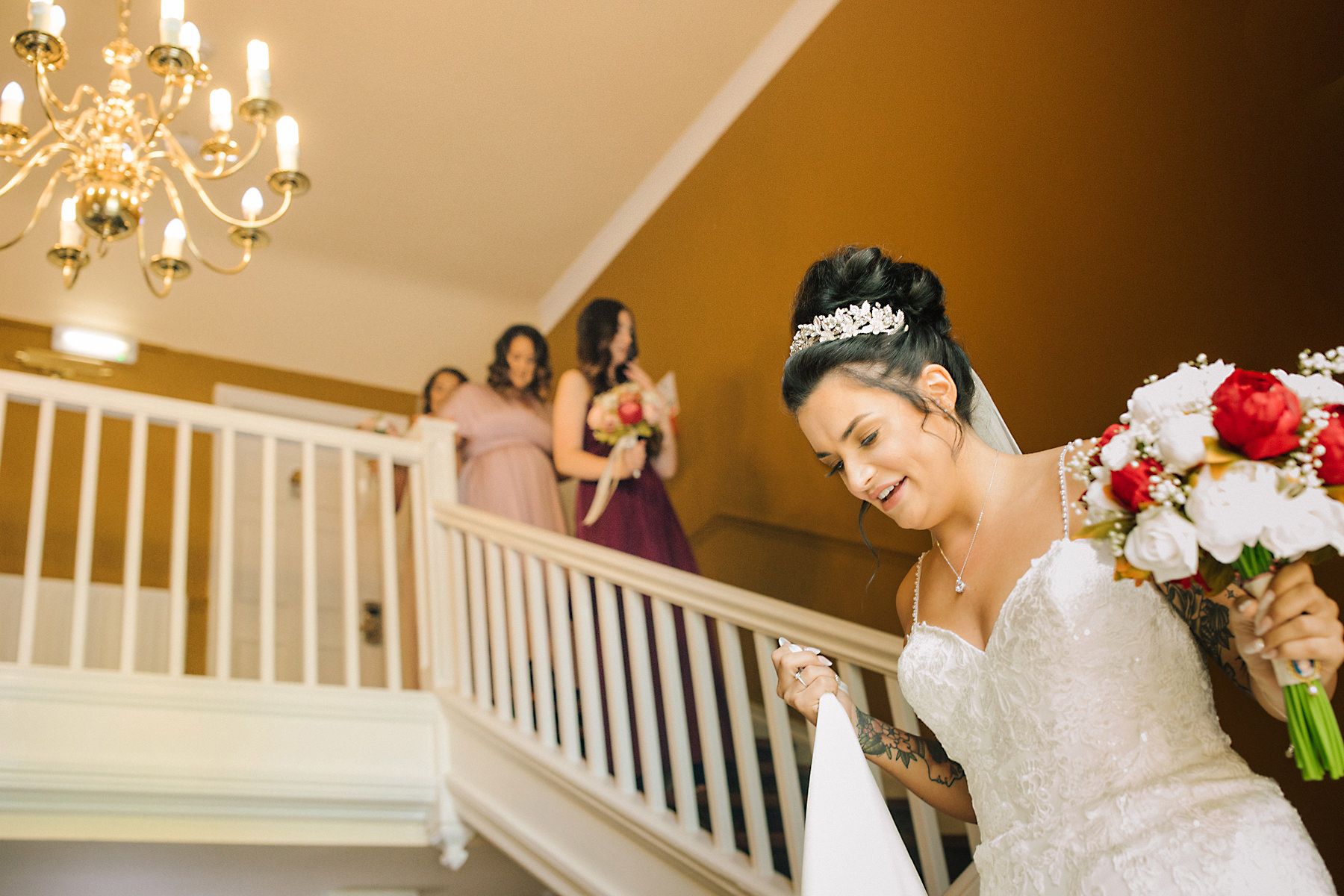 bride on staircase at chimney house hotel