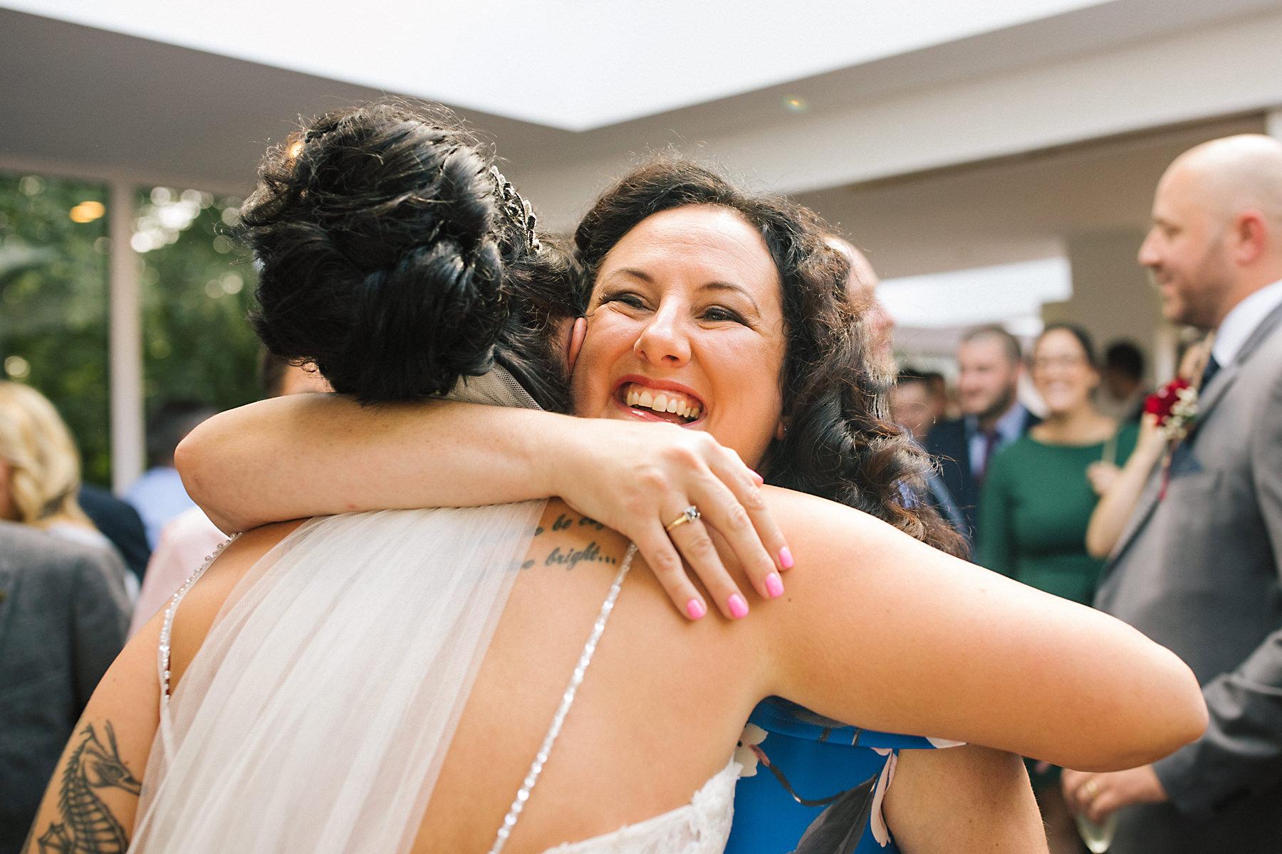 guests hugging at wedding