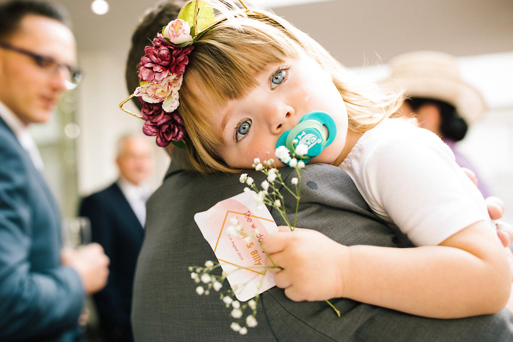 tired flowergirl at wedding
