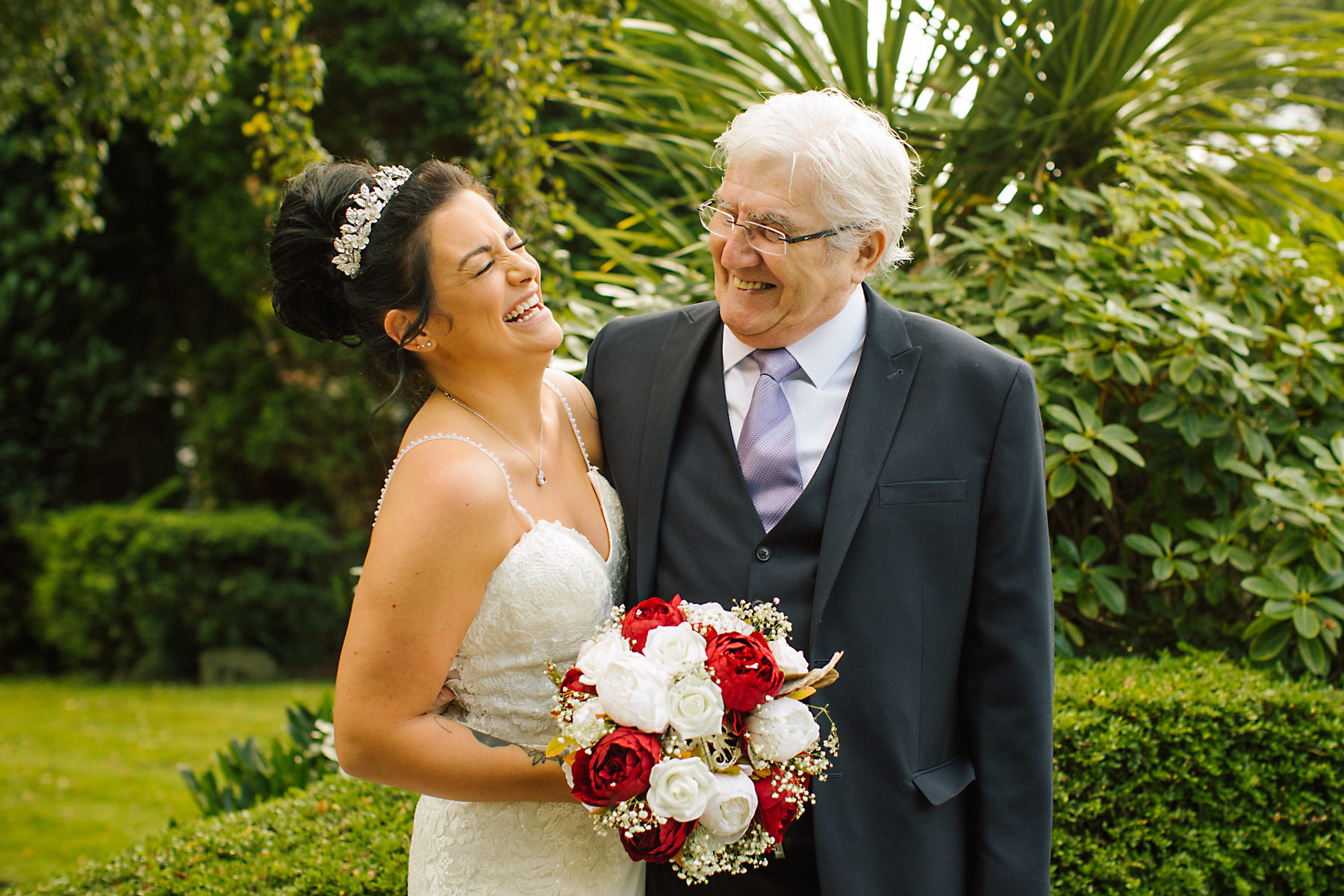bride and grandad laughing